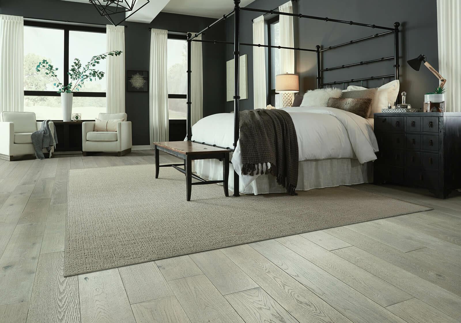 custom area rug in bedroom | Sterling Carpet Shops, Inc